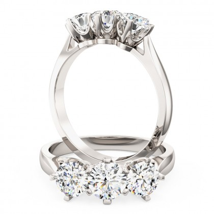 A classic Round Brilliant Cut three stone diamond ring in platinum (In stock)