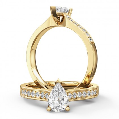 A beautiful pear shaped diamond ring with shoulder stones in 18ct yellow gold