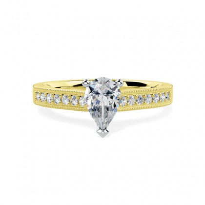 A beautiful Pear shaped diamond ring with shoulder stones in 18ct yellow & white gold