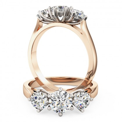 A classic Round Brilliant Cut three stone diamond ring in 18ct rose & white gold