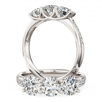 A modern three stone diamond ring with shoulders in 18ct white gold
