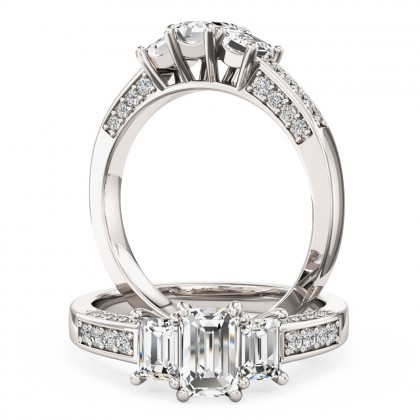 A classic Emerald Cut three stone diamond ring with shoulders in platinum