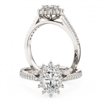 A classic oval diamond cluster style ring with diamond shoulders in platinum