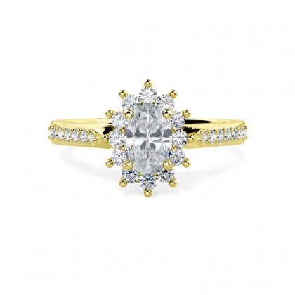 An oval diamond halo style ring with diamond shoulders in 18ct yellow gold