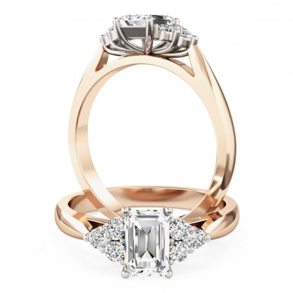 A classic emerald cut diamond ring with small round shoulder stones in 18ct rose & white gold