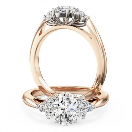 An oval and round brilliant cut diamond ring in 18ct rose & white gold