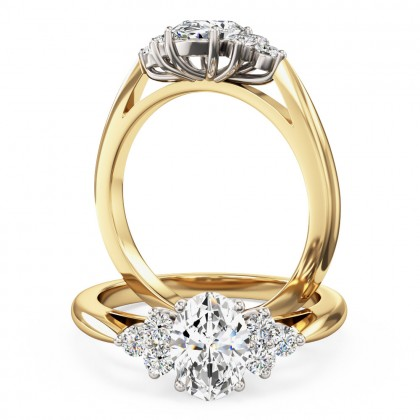 An oval and round brilliant cut diamond ring in 18ct yellow & white gold