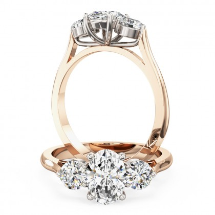 A stylish oval cut diamond 3 stone ring in 18ct rose & white gold