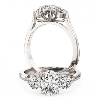 A stylish oval cut diamond 3 stone ring in platinum
