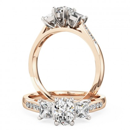 A beautiful oval and princess cut diamond ring with shoulder stones in 18ct rose & white gold