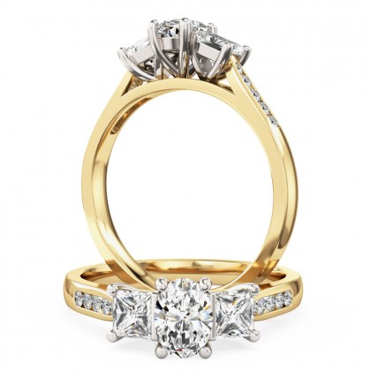 A beautiful oval and princess cut diamond ring with shoulder stones in 18ct yellow & white gold