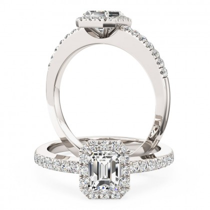 A stunning Emerald cut diamond ring with shoulder stones in platinum