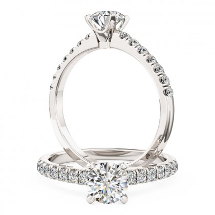 A beautiful Round Brilliant Cut diamond ring with shoulder stones in 18ct white gold (In stock)