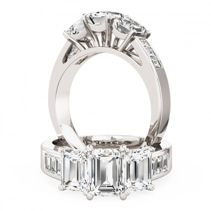 A breathtaking emerald cut three stone diamond ring with shoulders stones in platinum