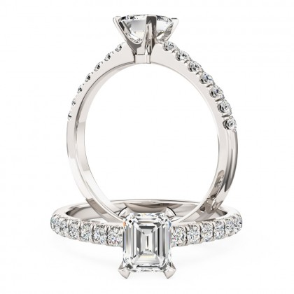 A beautiful Emerald Cut diamond ring with shoulder stones in platinum (In stock)