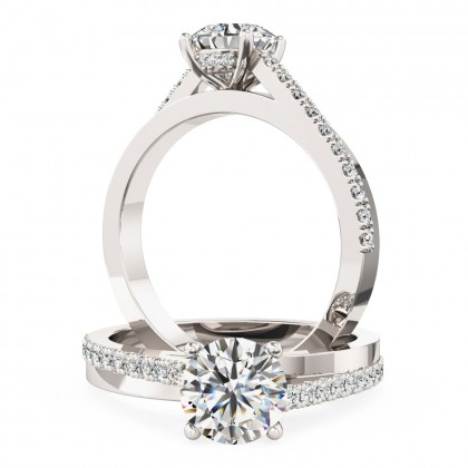 A delightful Round Brilliant Cut diamond ring with shoulder stones in 18ct white gold