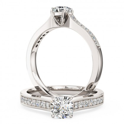A beautiful Cushion Cut diamond ring with shoulder stones in platinum