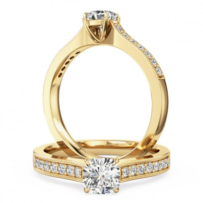 A beautiful cushion cut diamond ring with shoulder stones in 18ct yellow gold