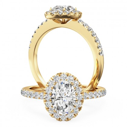 A stunning oval cut diamond halo with shoulder stones in 18ct yellow gold