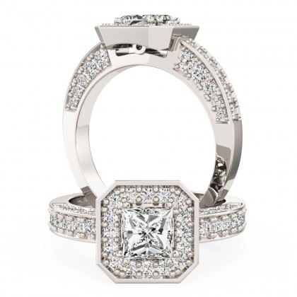 A magnificent Princess Cut diamond ring with shoulder stones in 18ct white gold