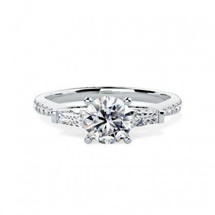 A stylish Round Brilliant Cut diamond ring with shoulder stones in 18ct white gold