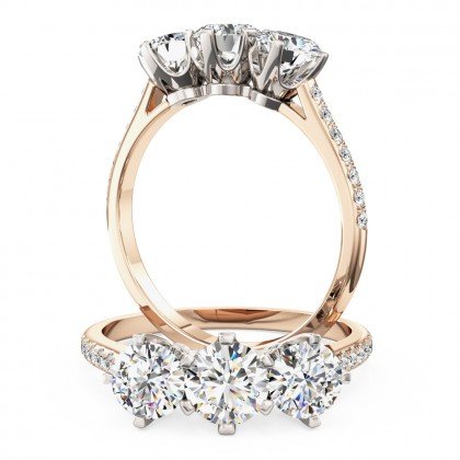 A stunning three stone diamond ring with shoulder stones in 18ct rose & white gold
