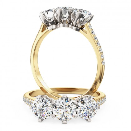 A stunning three stone diamond ring with shoulder stones in 18ct yellow & white gold