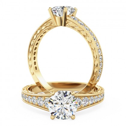 A beautiful round brilliant cut diamond ring with shoulder stones in 18ct yellow gold (In stock)