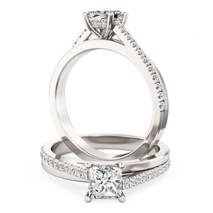 A delightful Princess Cut diamond ring with shoulder stones in platinum (In stock)