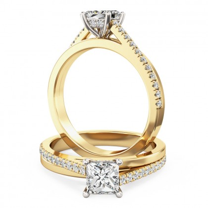 A delightful princess cut diamond ring with shoulder stones in 18ct yellow & white gold