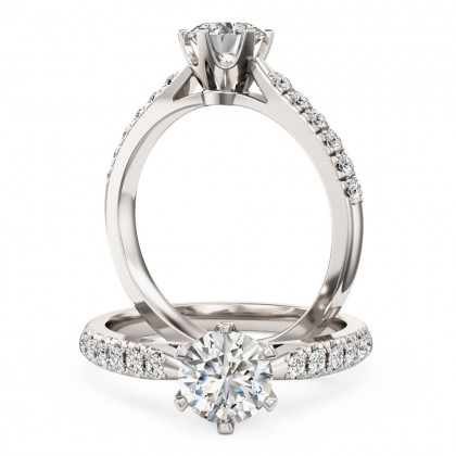 An exquisite solitaire diamond ring with shoulder stones in 18ct white gold (In stock)