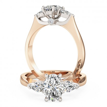 An exquisite oval and pear shape diamond ring in 18ct rose & white gold