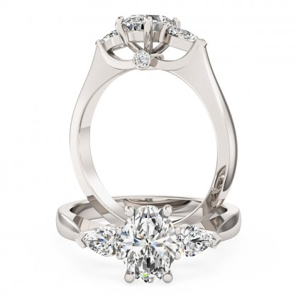 An exquisite oval and pear shape diamond ring in 18ct white gold