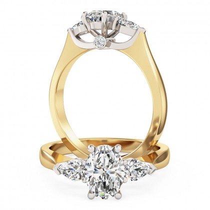 An exquisite oval and pear shape diamond ring in 18ct yellow & white gold