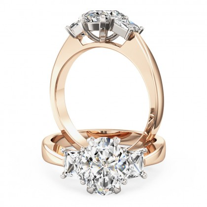 An exquisite oval and trapezium cut diamond ring in 18ct rose & white gold