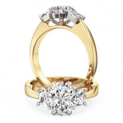 An exquisite oval and trapezium cut diamond ring in 18ct yellow & white gold