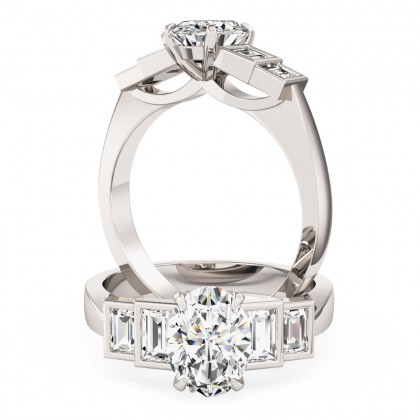 An exquisite oval and baguette cut diamond ring in platinum