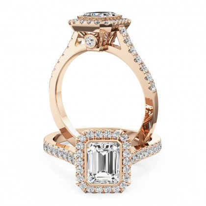 A stunning emerald cut diamond cluster with shoulder stones set in 18ct rose gold