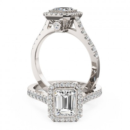 A stunning Emerald cut diamond cluster ring with shoulder stones set in platinum (In stock)