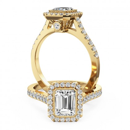 A stunning emerald cut diamond cluster with shoulder stones set in 18ct yellow gold