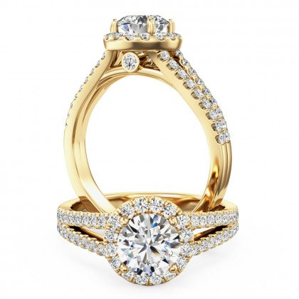 A stunning diamond halo cluster with shoulder stones in 18ct yellow gold