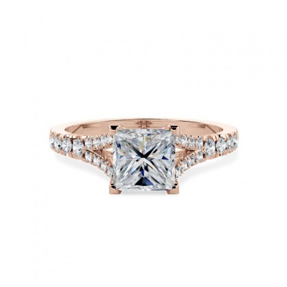 An exquisite princess cut diamond ring with shoulder stones in 18ct rose gold