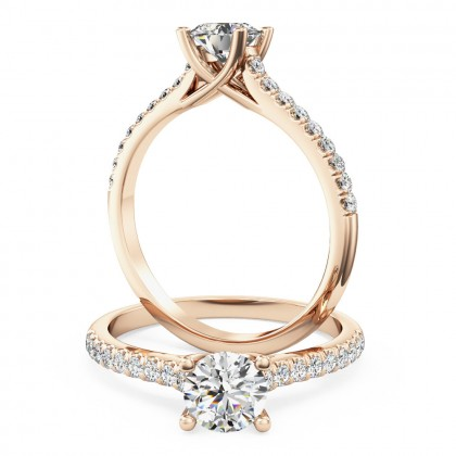 A beautiful Round Brilliant Cut diamond ring with shoulder stones in 18ct rose gold