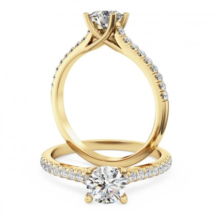A beautiful round brilliant cut diamond ring with shoulder stones in 18ct yellow gold