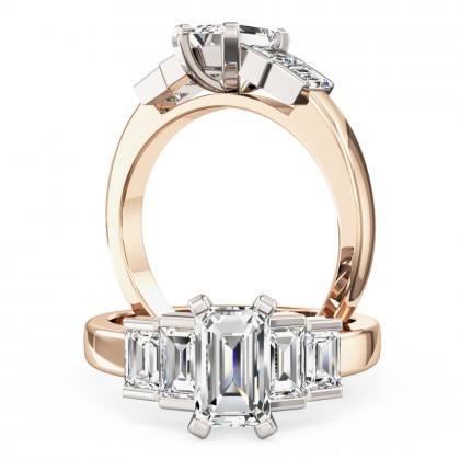 A stylish emerald & baguette cut five stone diamond ring in 18ct rose & white gold