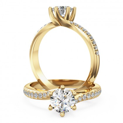 A stunning round brilliant cut diamond ring with shoulder stones in 18ct yellow gold