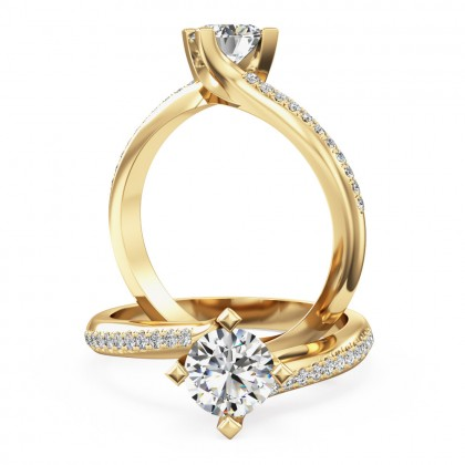 An exquisite solitaire diamond ring with shoulder stones in 18ct yellow gold