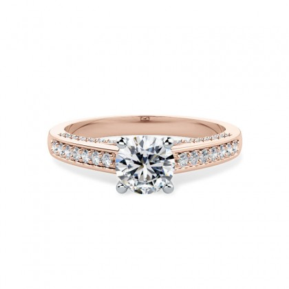 An exquisite solitaire diamond ring with shoulder stones in 18ct rose & white gold
