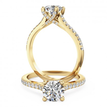 A beautiful diamond solitaire ring with shoulder stones in 18ct yellow gold