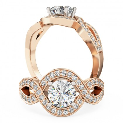 An exquisite round brilliant cut diamond ring with shoulder stones in 18ct rose & white gold